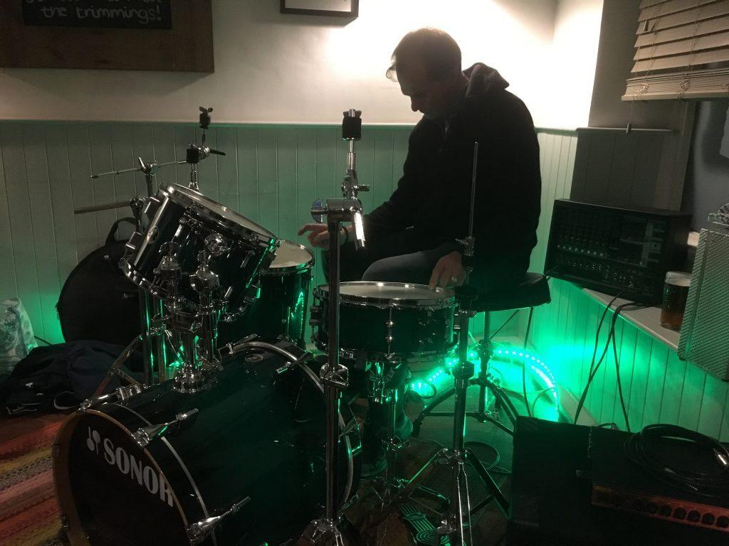 U-Turn Band Pete Roberts setting up drum kit